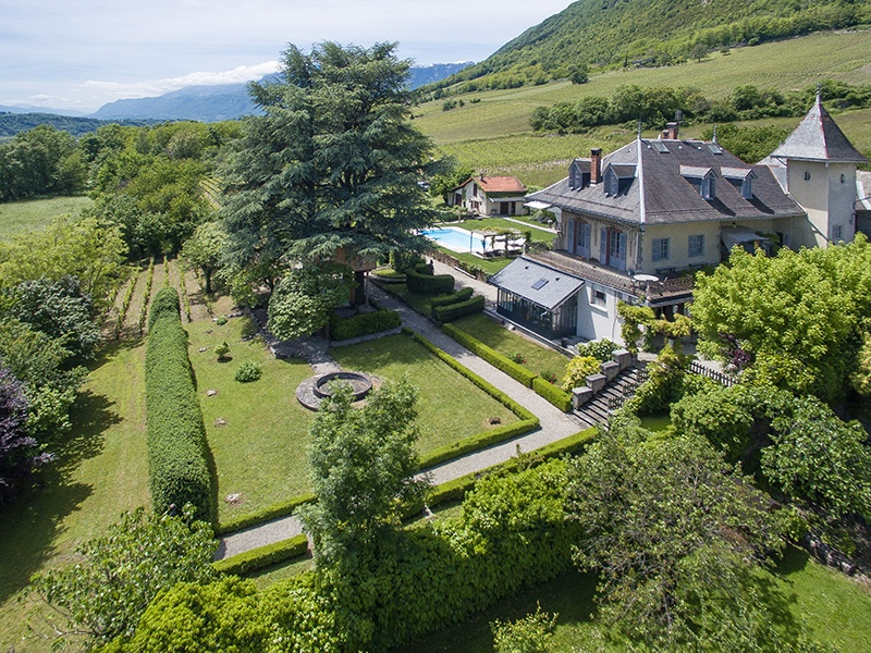 Full of character, this estate between Chambéry and Albertville benefits from its quiet location, large garden, and panoramic view of the surrounding mountains. Photograph: Agence Clerc