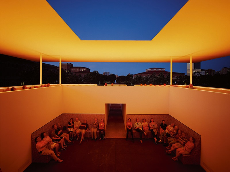 Constructed of grass, concrete, stone, and composite steel, James Turrell's <i>Twilight Epiphany</i> Skyspace illuminates just before sunrise and at sunset to complement the ambient light. Photograph: Florian Holzherr