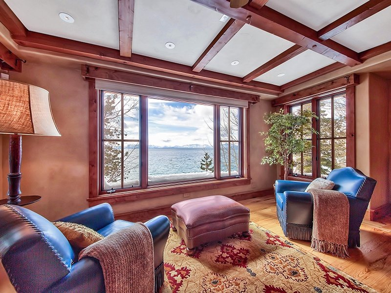 In addition to four bedrooms, a library, a game room, a home theater, a wine cellar, an exercise room with sauna, and an elevator, the home comes with a fishing boat. Photograph: Oliver Luxury Real Estate