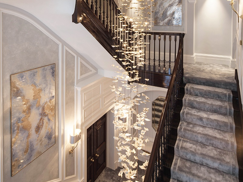 Hand-crafted bespoke lighting designed by Katharine Pooley creates an impressive focal point in this London home. Photograph: Richard Waite