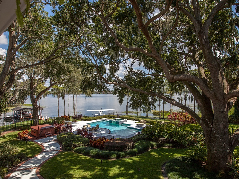 In addition to a heated pool and spa in the spacious backyard, the property has a boat dock with lift on the lake. Photograph: Regal Real Estate Professionals