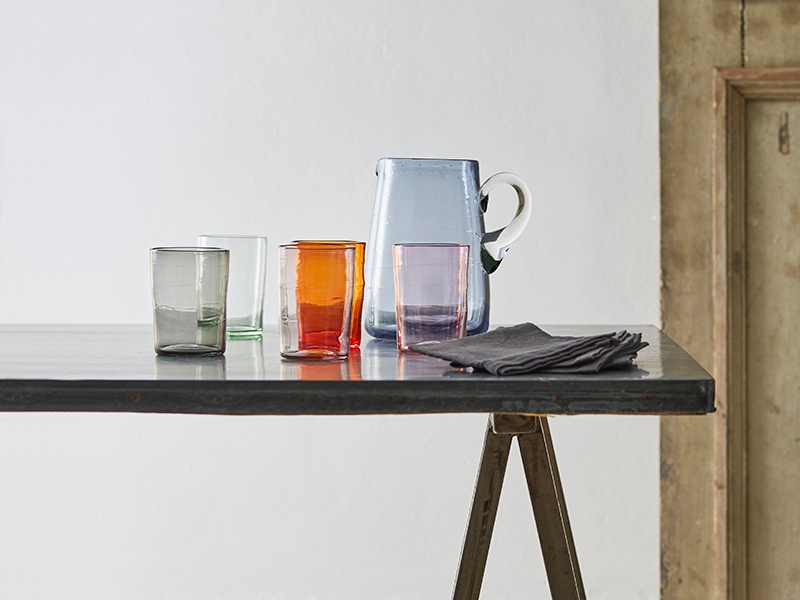 Michael Ruh hand-blows one-of-a-kind glass vessels—many featuring delicate, abstract line-work spun around the inside.