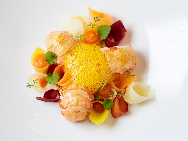 Starters at La Dame de Pic London include Scottish langoustine seared in shellfish butter and infused with pine tree and geranium rosat.