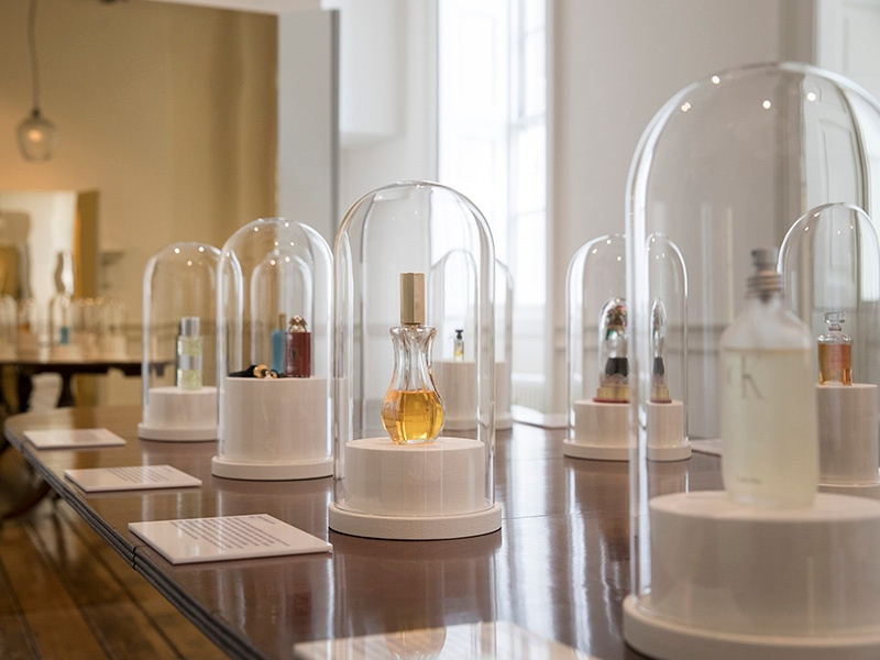 "Visitors to <i>Perfume: A Sensory Journey Through Contemporary Scent</i> will explore a series of rooms that reflect the inspiration behind fragrances made by ""perfume pioneers."" The exhibition also highlights ten trailblazing scents, beginning with L'Origan de Coty (1905) and ending with ck one (1994). Photograph: Peter MacDiarmid. Banner image: Han's fragrances are associated with limited-edition numbered art prints inspired by the perfume."