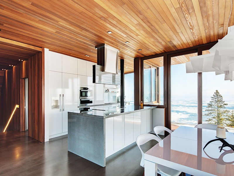 "Thanks to a clever ""pass"" window, the kitchen allows for indoor–outdoor dining. Photograph: Alexandre Guilbeault"