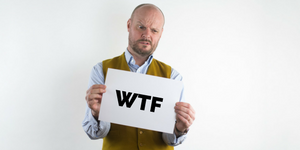 Man holding a piece of paper which says