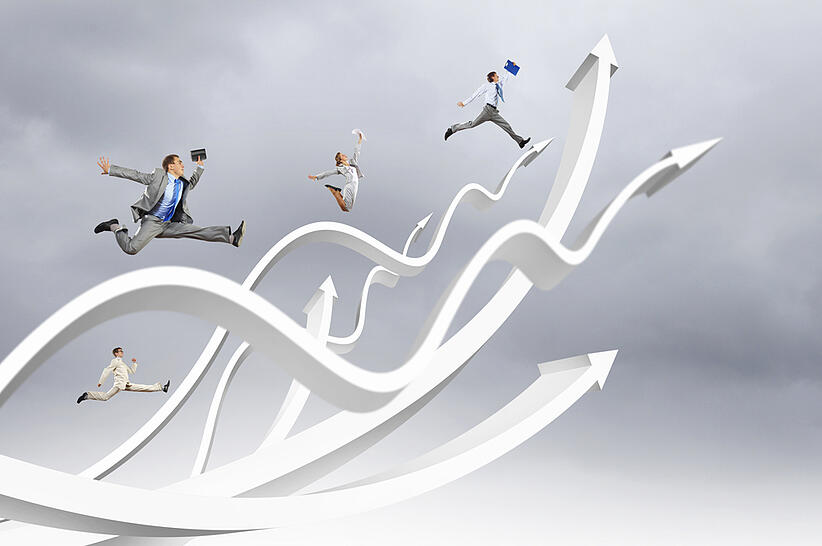 Young businesspeople jumping on white arrows. Growth concept-1