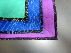 Backing and binding on a T-shirt quilt