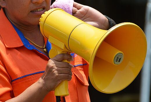 Person yelling through megaphone