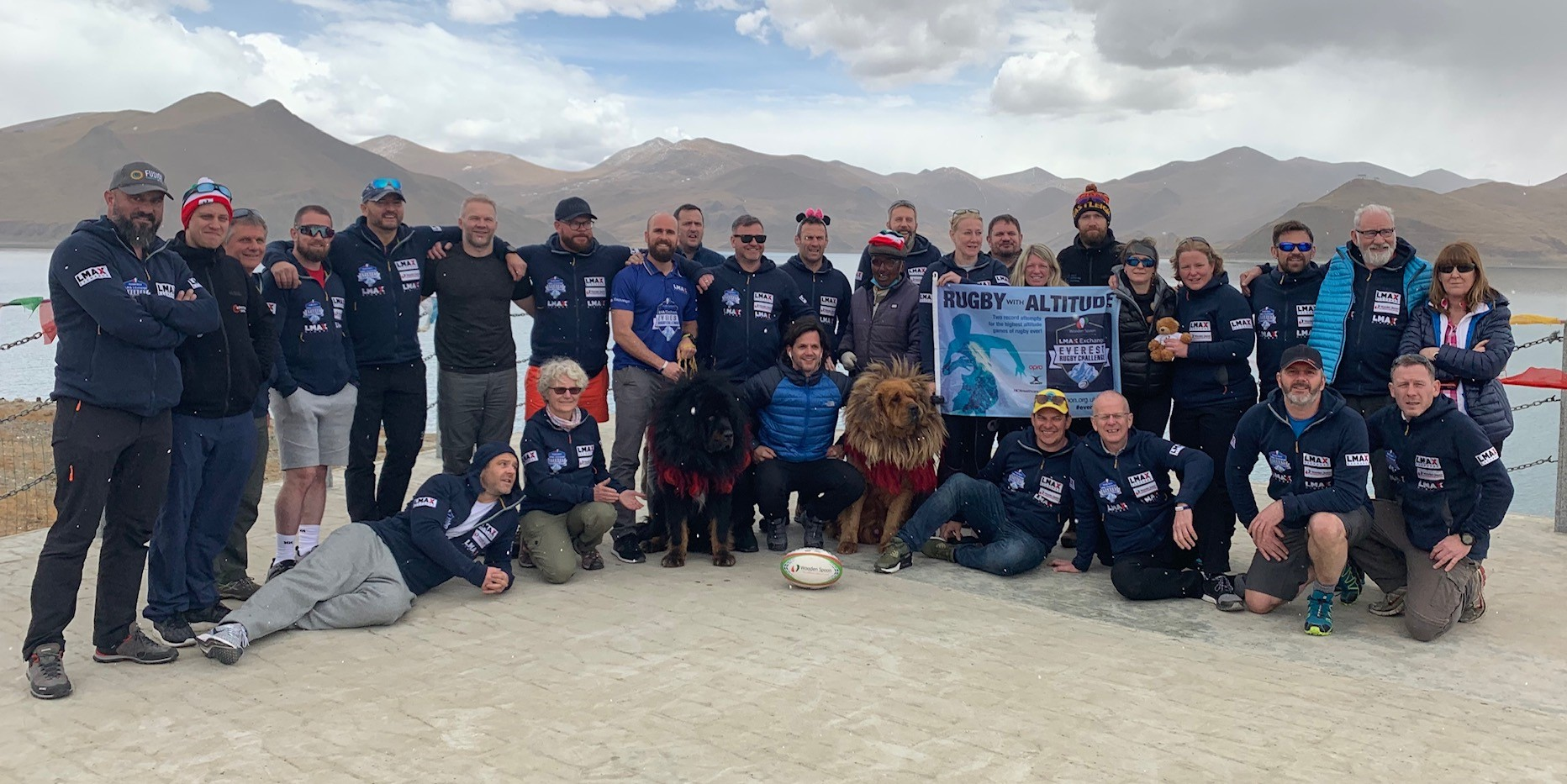 LMAX Rugby Challenge rugby team is posing in a group photo in Tibetan plateau and highlands.