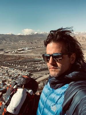Georgios Tsianos posing on the background of Gyantse, Tibet.