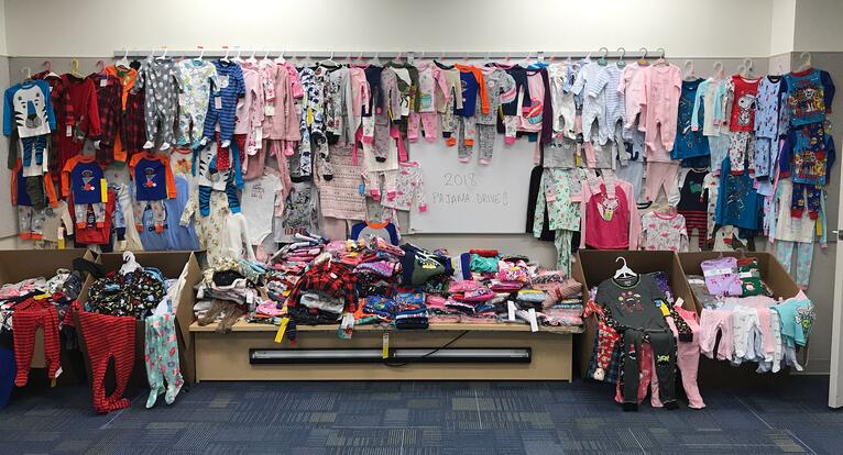 CyberGrants employees collect over 1,200 pairs of pajamas for local families in need!