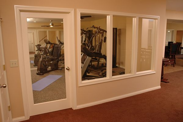 Need more living space check out these lower level remodels for Basement workout room