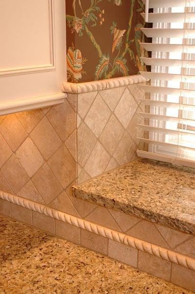 Kitchen Backsplash With Diamond Tile Pattern And Tile Liner