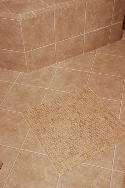 Slip resistant tile in a walk in shower for Slip resistant bathroom flooring