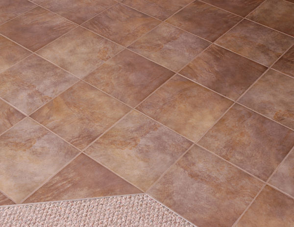 Vinyl Sheet Flooring Is Made To Look Like Stone And Ceramic Tile And