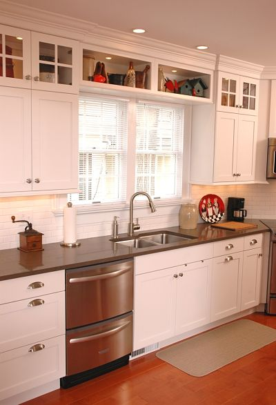 Project spotlight renovated galley style kitchen in a for Ideas for things to put on top of kitchen cabinets