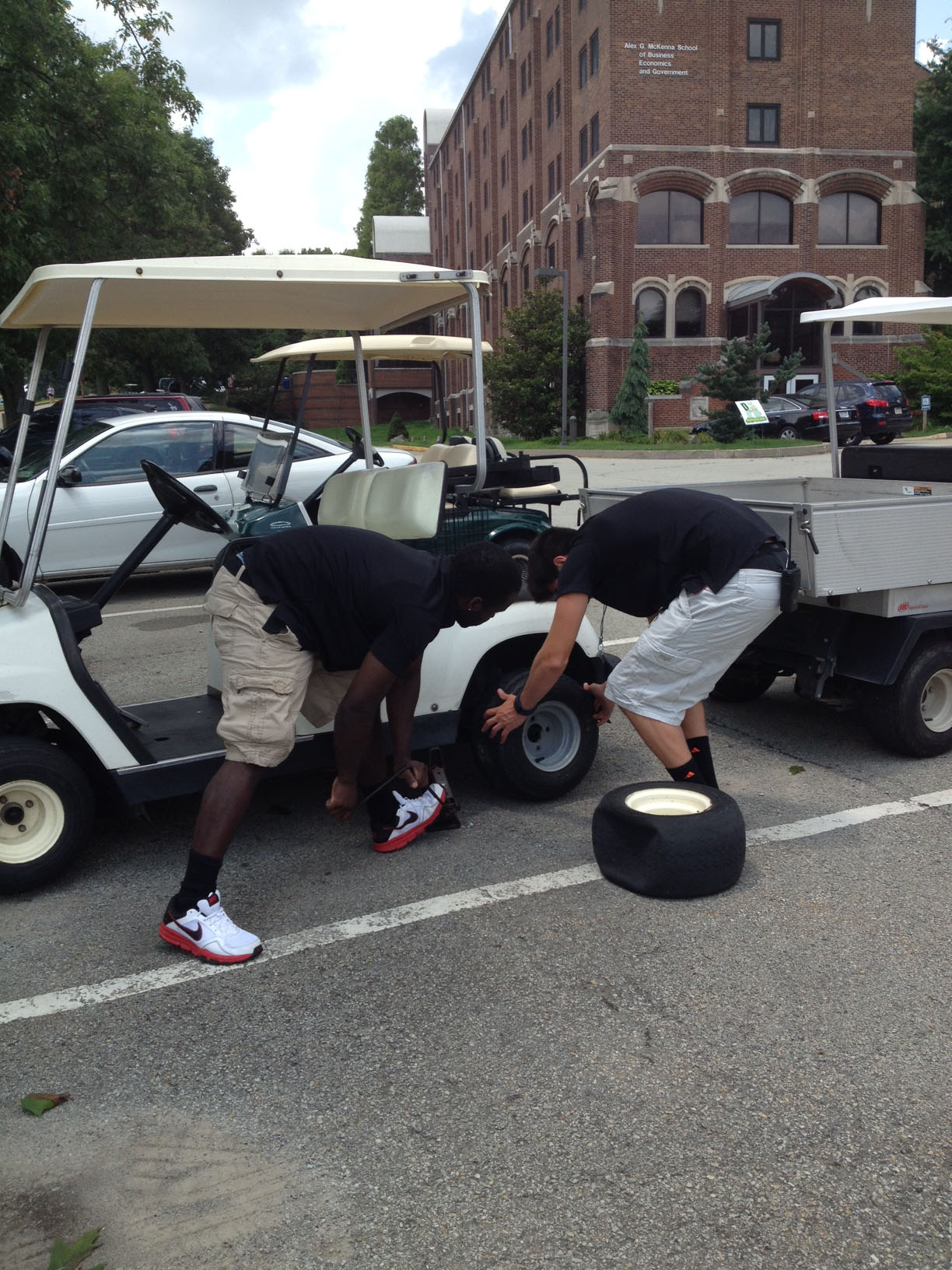 Replacing a flat tire at Saint Vincent College