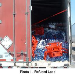 Bottles of water in trailer that were damage during shipment
