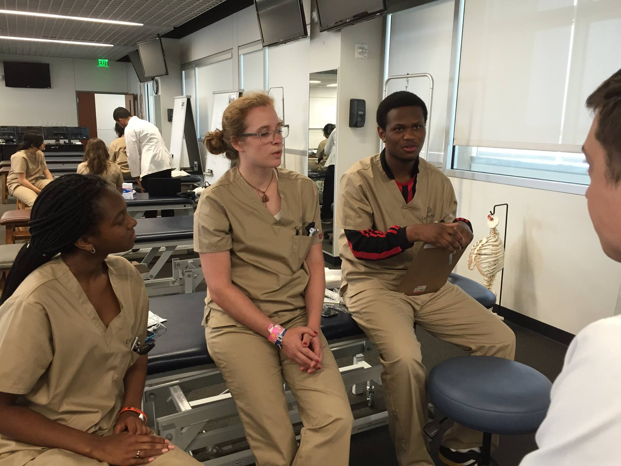 Camp Neuro students in a workshop with medical professionals.