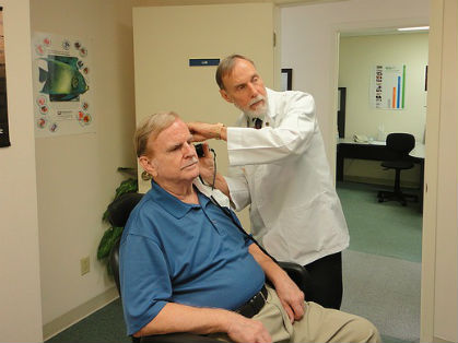 Man receiving a hearing test from a qualified medical professional