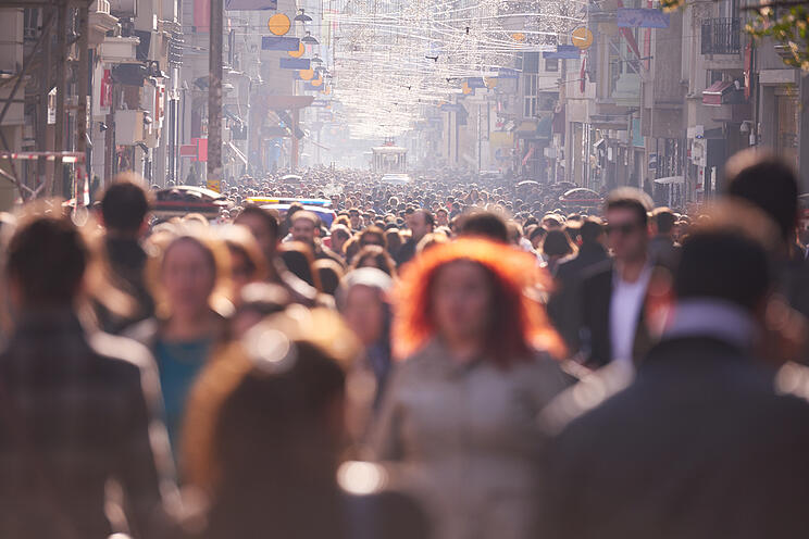 people crowd walking on busy street on daytime-1