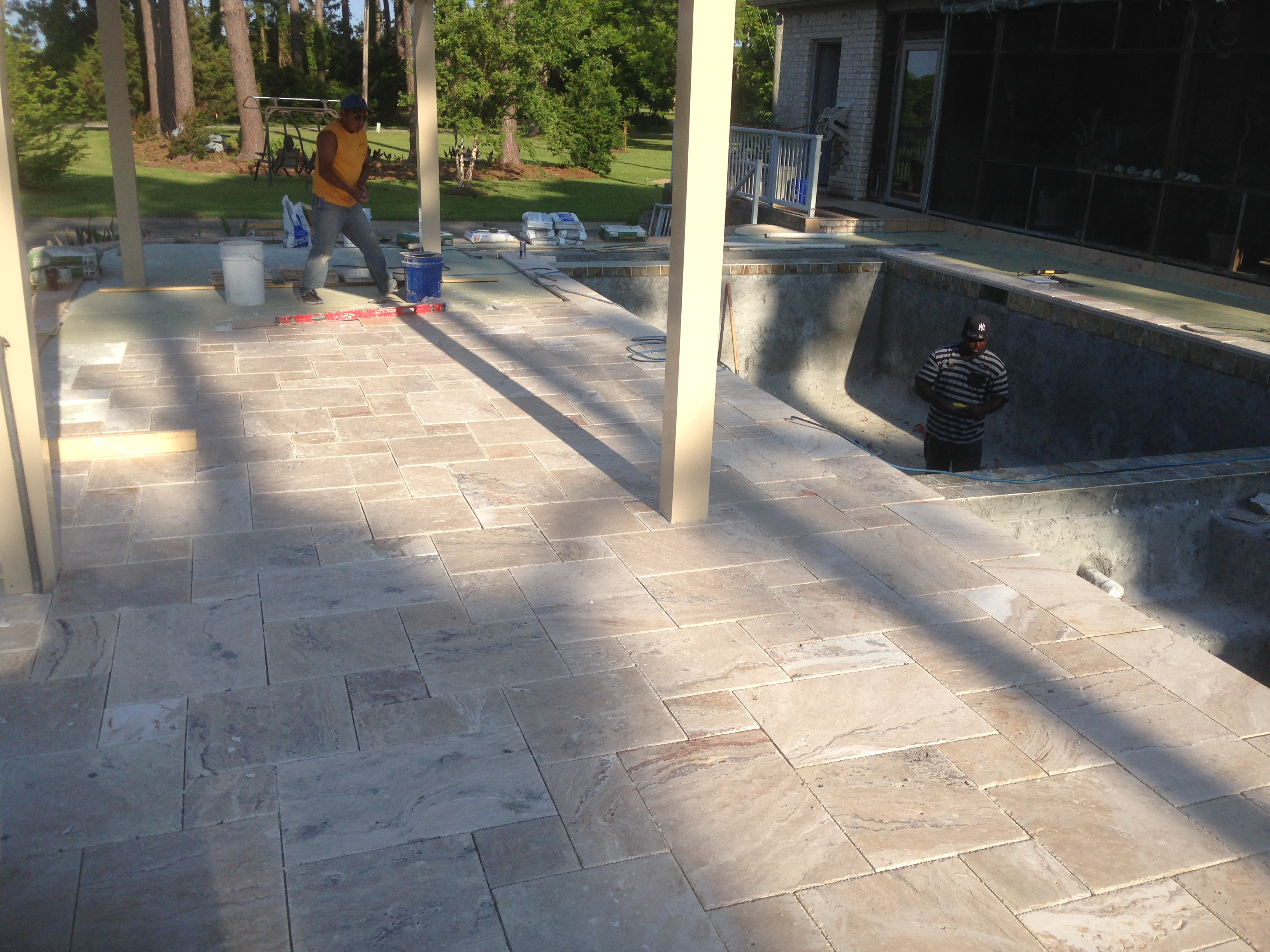 Swimming pool renovations commercial and residential travertine tile install going well almost ready for grout dailygadgetfo Choice Image