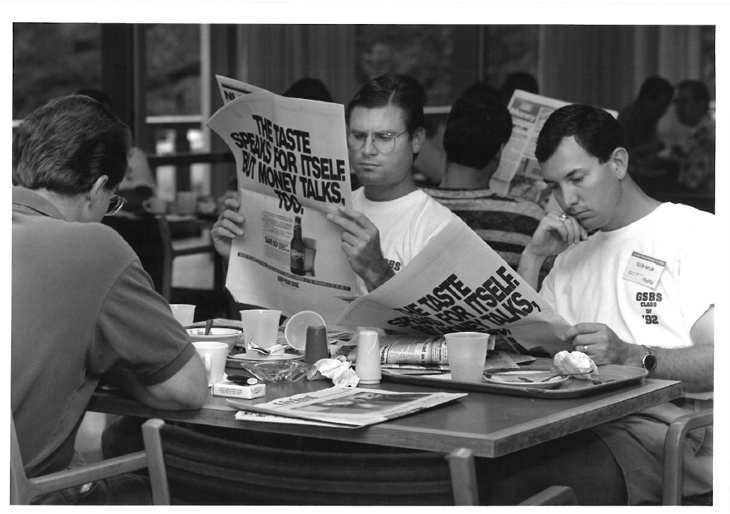 Two members of the Class of '92, catching up on the news at breakfast