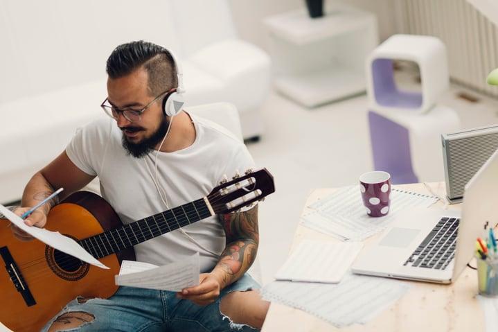 Musician-Composing-Music-In-His-Recording-Studio-000067914795_Medium.jpg