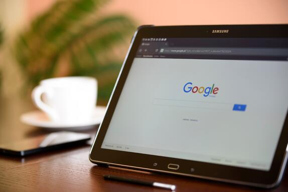 Open laptop displaying Google's search page representing inbound marketing keywords