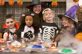 photodune-332224-four-young-friends-and-a-woman-at-halloween-eating-treats-and-smiling-xs