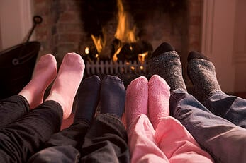 photodune-340340-family-of-feet-warming-at-a-fireplace-xs