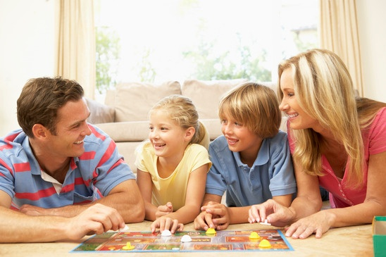 family-playing-board-game-at-home-xs