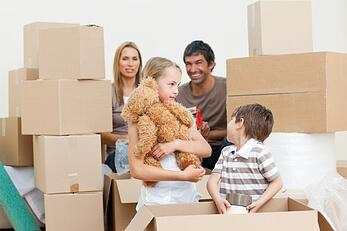 family-unpacking-boxes-after-move-in-xs