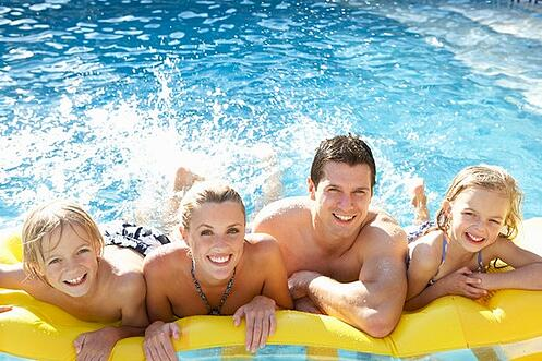 photodune-330863-young-family-having-fun-together-in-pool-xs-1