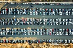 birds eye view of full parking lot