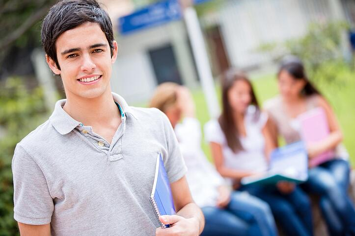 Casual male student at college looking happy - How foodservice workers can help new freshmen