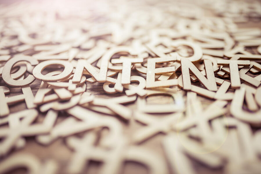 the word content spelled out in metal colored letters