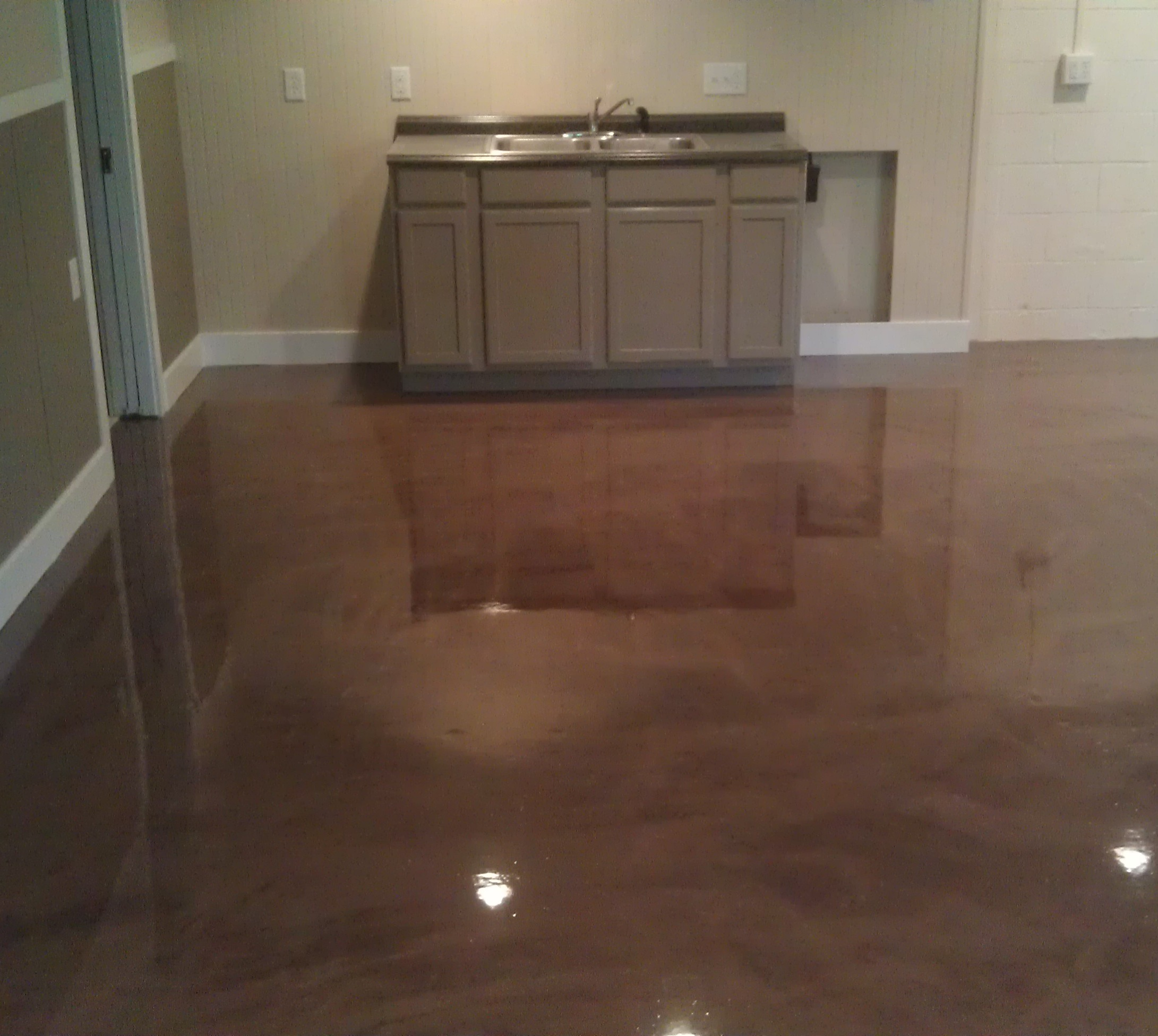 What 39 s new in concrete flooring for Cleaning cement basement floor