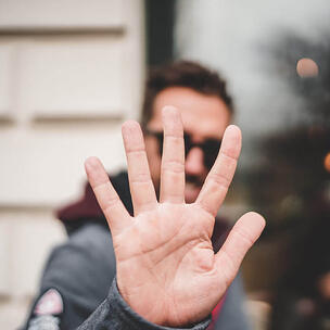 celebrate national high five day - photo by Zan via unsplash