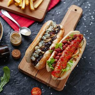 Enjouy a hot dog on National Hot Dog Day - photo by Victoria Shes via Unsplash