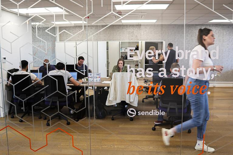 Sendible office brand tagline