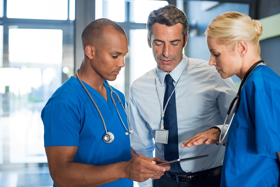 bigstock-Medical-team-interacting-using-188816575