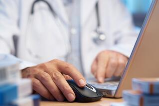 bigstock-Doctor-Preparing-Online-Intern-6232221.jpg
