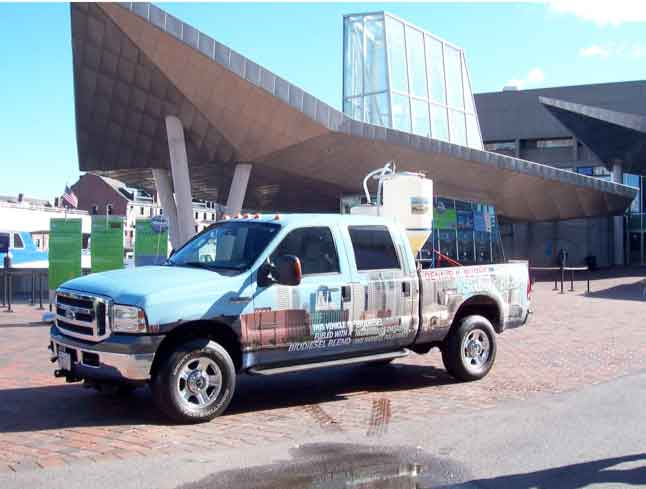 BioFuels pickup truck parked infront of a modern buidling