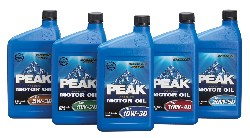 5 bottles of Peak motor oil