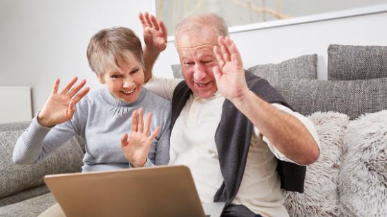 Couple Waving At Computer Screen