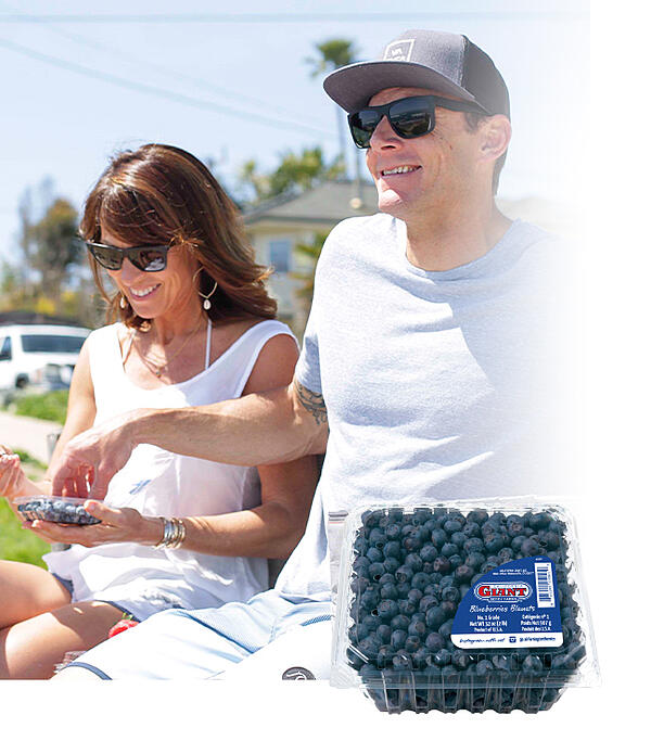 couple sharing blueberries
