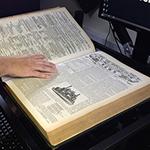 Mark-checking-book_thumb