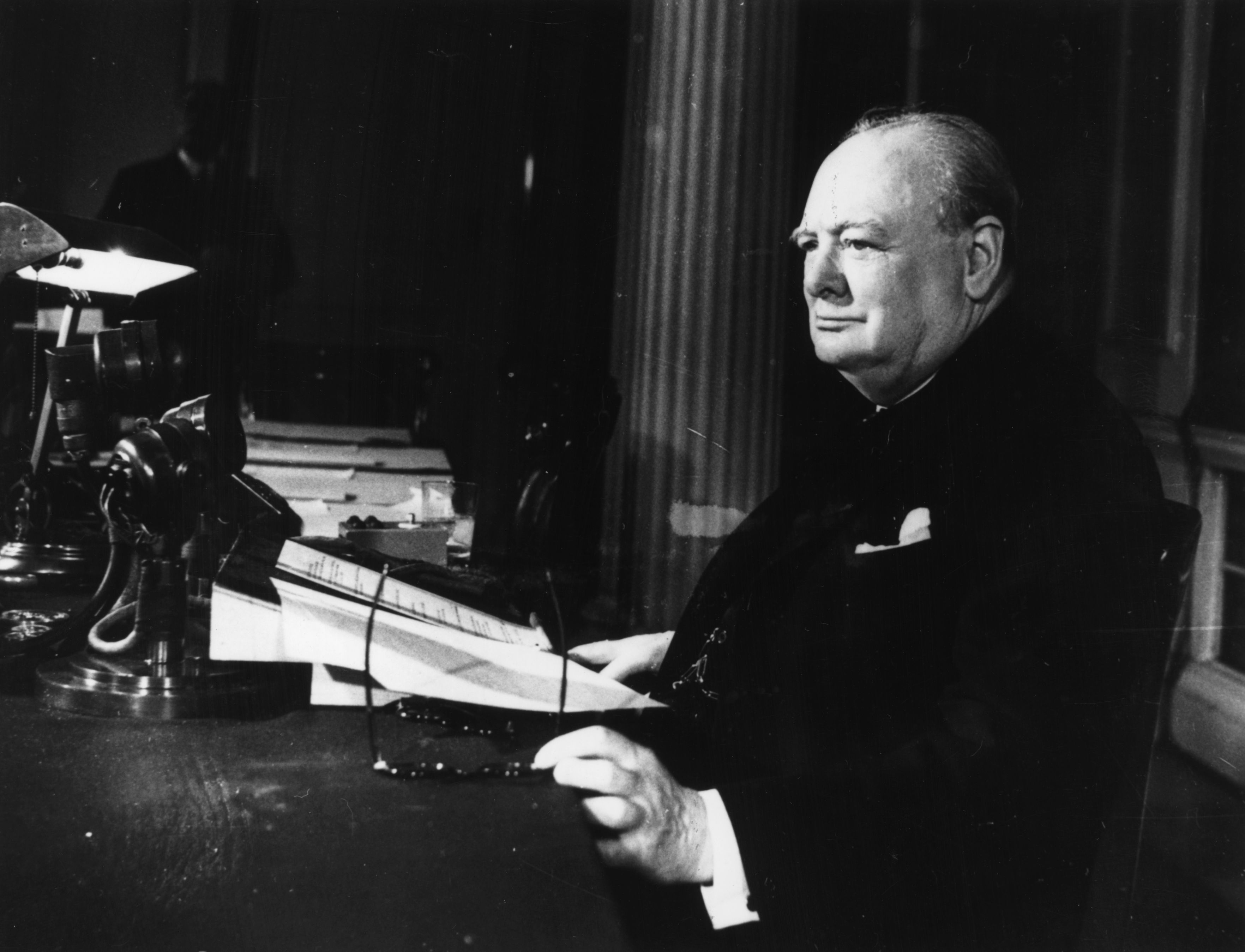 Churchill writing at his desk